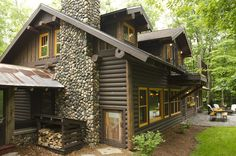 With a dark-stained log exterior and fieldstone chimney, this is the quintessential cabin. As with many homes of the past, cabins were built...