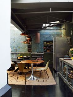 Green and blue kitchen with industrial touches