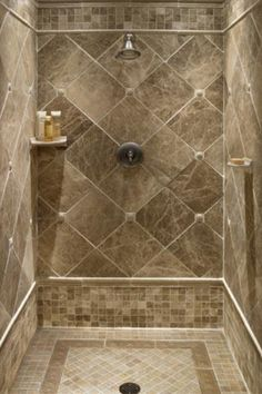 small tiles floor and large diamond-cut shape tiles for shower wall small single floating shelf for bathing properties a planted shower-head