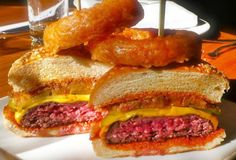 Multiple-time Burger Bash Champion, Lure Fishbar makes just a straight-up great cheeseburger with the works: lettuce, pickles, and special sauce on a brioche bun. An gigantic onion ring garnish never hurt anything either.