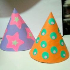 How to make kids party hats via @Guidecentral - Visit www.guidecentr.al for more #DIY #tutorials