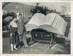 """1930: The Waynai Bible. """"This copy of the entire King James Bible was completed by Louis Waynai in Los Angeles, CA, in 1930, two years after he had begun the project. Devoting more than 8,700 hours to the book, Mr. Waynai printed the text using a large home-made rubber stamp press. When laid open, the Waynai Bible measures 43.5 inches tall and 98 inches wide. Closed, the spine is 34 inches thick. The book has 8,048 pages and weighs in at 1,094 pounds."""""""