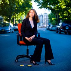 Great light on unexpected background - business portrait.  how fun!