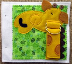 """Designed for little hands, """"Button Nose"""" will engage your little one… and delight YOU as well!  You can make """"Button Nose"""" today….. the .PDF PATTERN is available for immediate download!  This fun, felt quiet book features a MANIPULATIVE activity on each page.  1. BUTTON the piggy's nose 2. SNAP the bunny's ears 3. UNZIP the frog's mouth 4. UNBUCKLE the dog's collar 5. STRETCH the elephant's trunk 6. THREAD the giraffe's neck through D rings 7. UNHOOK the elastic loop to find the baby chick…"""