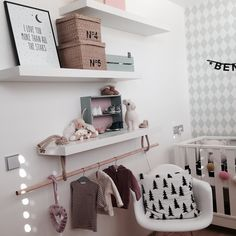 Nursery in neutrals. Ferm Living harlequin wallpaper.