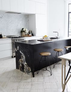 White marble — especially the snowy and subtly veined carrara — has long been a dominant material in kitchens. If you're looking for something a little different, or want to embrace the trend of darker, more layered looks that are coming to the kitchen lately, consider black marble. It has all the loveliness of its lighter counterparts, stains less easily, and is a great way to add class and character.