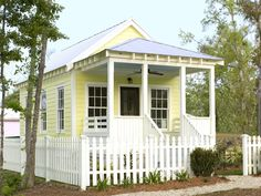 Cheerful Yellow Cottage Designed by Katrina Cottages, this charming little one-bedroom house measures 14-feet wide and 30-feet long, including a miniature front porch.