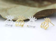 Check out this item in my Etsy shop https://www.etsy.com/listing/215924259/frog-prince-stud-earrings-unique-gift