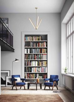 Gray library with modern light fixtures and details