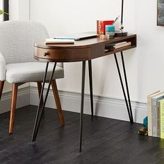 "Pencil Desk from West Elm | Look sharp. Set on retro hairpin legs, our Pencil Desk's slim profile and rounded side drawer help keep small spaces organized. It's made in India of solid mango wood and protected by a warm Chestnut finish.  $399  38""w x 18""d x 30""h. Solid mango wood with a Chestnut finish. Blackened metal legs. Made in India."