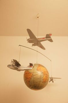 interesting golden age airplanes with globe...