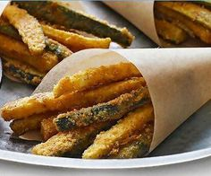 ☜ Oven-Baked Zucchini Fries  makes approximately 8 servings Ingredients 3 zucchini (1 lb.) 1/4 cup Grated Parmesan Cheese 1 packet Shake & Bake Coating Mix 1 small egg  Method:  Heat oven to 450ºF. Trim the zucchini -cut crosswise in half, then cut each piece into 1/4-inch sticks. Add cheese to coating mix in shaker bag; shake gently to combine. Whisk egg in medium bowl. Add zucchini; toss to coat. Use tongs to place 1/4 of the zucchini in shaker bag; close bag and shake to evenly coat…