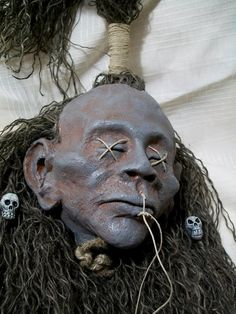 Shrunken Head / creepy shrunken head with skull beads by GRavenNY, $45.00 Well, I do love horror, but above and beyond that this is made so well and looks so creepy and realistic I just had to share. If you like creepy be sure to click the photo to go to their shop and check out all the insanely cool pieces there. You won't be sorry!