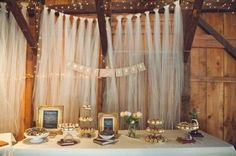 Backdrop of tulle and string lights.