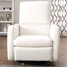 $875 Come home and take a load off in this Natuzzi tyraini recliner. A contemporary comfort solution, this off-white leather recliner has detailed stitching, a durable wood frame and a beautiful glazed nickel base.