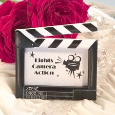 Resin Movie Clapboard Style Place Card Frame - Set of 20     It's lights camera action at your event with these movie themed place card frames as your party favors You can give your guests their chance to feel like they're up on the silver screen when you display their names in these playful movi...