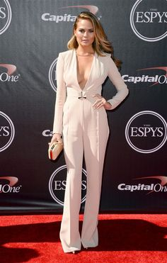 Wow! Chrissy Teigen looked smokin' hot at the 2014 ESPY Awards. She wore a deep-V Elisabetta Franchi jumpsuit that made our jaws drop. Like us on Facebook?