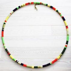 hula hoop wrapped in yarn wall art