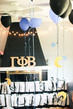 Crescent moons hanging from balloons (To Infinity & Beyond! Bid Day theme) - Delta Chi Gamma Phi Beta - 2012