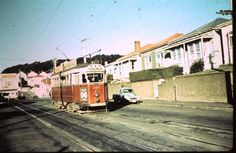 "An Island Bay bound ""Fiducia"" class tram in Luxford Street, Berhampore. The Island Bay tram route close in May 1963."