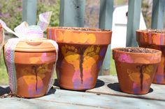 Footprint butterfly flower pots - planted bulbs and tied the lid with a bow. Happy mother's day :)