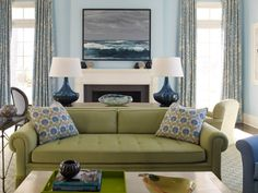 Though not always a fan of powder blue in rooms other than a bedroom or bathroom, looks nice with this green couch, blue accents. A good option with blue walls & this sage green couch. Living Room Color Schemes, Living Room Colors, Colour Schemes, Living Room Redo, Living Room Furniture, Green Furniture, Olive Green Couches, Green Sofa, Blue And Green Living Room