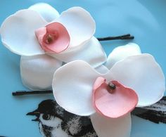 pretty orchid bobbies that don't look like fake flowers from Michaels hot-glued to bobby pins...