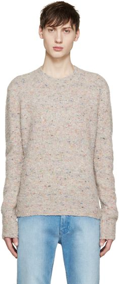 Long sleeve knit sweater in beige featuring multicolored speckling. Pilled texture throughout. Ribbed crewneck collar, sleeve cuffs, and hem. Tonal stitching.