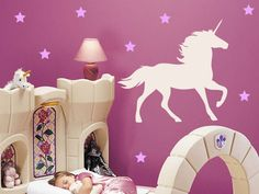 Unicorn and Stars Wall Decal for a perfect little girls bedroom. These wall decals create a strong and colorful contrast with the dark wall color and work beautifully with the novelty bed surrounds.