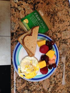 Advocare 24 Day Challenge Day Two: Her Breakfast, toast, microwaved egg, mixed fruit and a fiber drink.