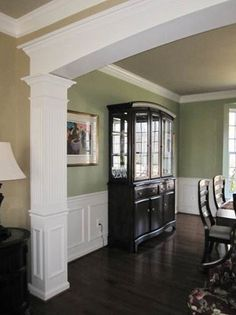 Dining Room with custom millwork archway, chair rail and panel moulding shadowboxes. Love the archway Green Dining Room, Dining Room Colors, Kitchen Colors, Design Kitchen, Dining Rooms, Dining Table, Panel Moulding, Moldings And Trim, Crown Molding
