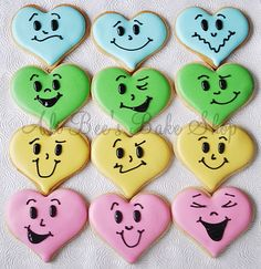 Heart Cookies with fun faces and shiny frosting.