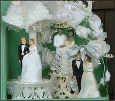 Collection of vintage wedding cake toppers.