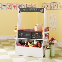 This 'Shop 'Til You Drop Market' from The Land of Nod is the perfect setup for your little shop girl or shop guy. Roomy bins hold tons of fruits, veggies and grocery staples. Sliding doors and overhead sign feature chalkboard so that kids can advertise their daily specials. Fun and educational. A great Christmas gift idea!