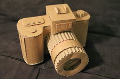 6 Gadgets that can be made out of Cardboard - Cardboard Box , 6 Gadgets that can be made out of Cardboard Have you ever thought about recycling those cardboard boxes which are lying around your house? We are gues. Cardboard Camera, Paper Camera, Cardboard Box Crafts, Cardboard Sculpture, Cardboard Toys, Paper Toys, Cardboard Playhouse, Cardboard Furniture, Cute Crafts
