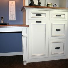Adding trim to existing plain kitchen cabinet doors. This is my ...