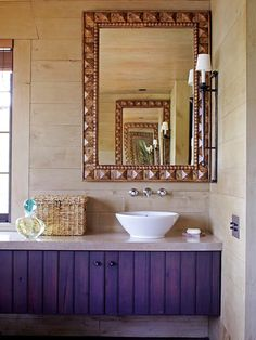 A floating vanity and vessel sink add hints of contemporary style to this cabin-style bathroom. The metal mirror frame was treated to look like wood, which allows it to blend effortlessly with the wooden wall panels. Bathroom Photos, Small Bathroom, Bathroom Ideas, Purple Wood Stain, Wooden Wall Panels, Purple Bathrooms, Bathroom Color Schemes, Dream Bath, Wall Treatments
