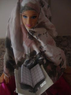 A miniature Qur`an holder for a doll