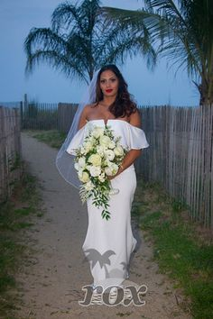 Ocean City Wedding Minister Sean Rox Is The Officiant For This Beautiful OC MD Beach Archway And Decorations By Weddings Htt