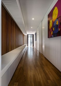 Modern Roadside House Design with Wooden Flooring: Beautiful Corridor With White Wall And Ceiling Also Wooden Floors Completed With Art Painting Decor ~ daily-inspirations.com Decorating Ideas Inspiration