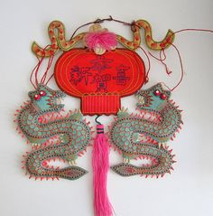 Antique Chinese wall hanging says Congratulations