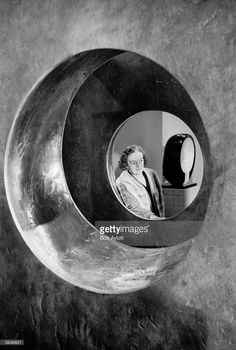 Sculptor Barbara Hepworth (1903 - 1975) with her sculpture 'Four Square Walk Through', which is part of a retrospective exhibition of her works on show at the Tate Gallery in London.