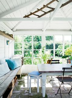 Besides the front porch, there's also a small conservatory, perfect for enjoying the outdoors when it's a little chilly outside, or for dining when the couple have lots of guests.