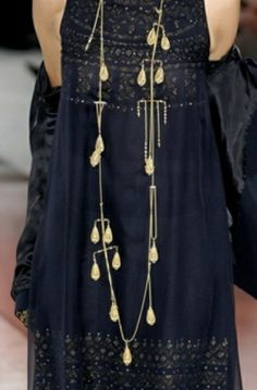 Lovely, long necklace adds drama