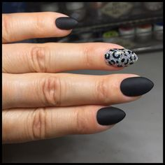 Bio Sculpture gel nails in matte black. Feature nail is silver holographic glitter with gel leopard print
