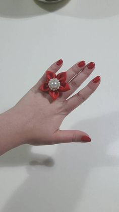 Check out this item in my Etsy shop https://www.etsy.com/listing/526441657/red-faux-leather-statement-pearl-flower