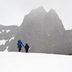 """Photo by @michaelclarkphoto // Hikers trekking in a snow storm in Karukinka Natural Park which is a private natural park in the Chilean part of Tierra del Fuego. This was a seriously remote region. After three full days of hiking we ended up rappelling into a 2000-foot deep canyon that we named the """"Valle Profundo"""" as we were the first humans to explore the region on foot. #chile #Karukinka #karukinkanaturalpark by natgeotravel"""