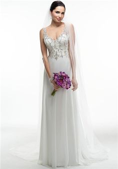 eca282f3f6727 Lightweight flowing Paris chiffon drapes this slim A-line gown with  dazzling Swarovski crystal bead