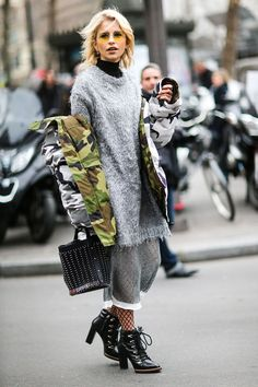 Street style girls are showing us how to wear camouflage in 2018. Get inspiration from their looks.