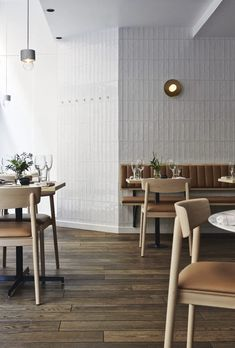 restaurant wall could we tile the entry wall Tan cushion on white bench and brass wall light. Michel Restaurant Helsinki by Joanna Laajisto Interior Design Blogs, Restaurant Interior Design, Interior Design Inspiration, Interior Ideas, Brewery Interior, Interior Design Portfolios, Furniture Inspiration, Cafe Restaurant, Banquette Restaurant